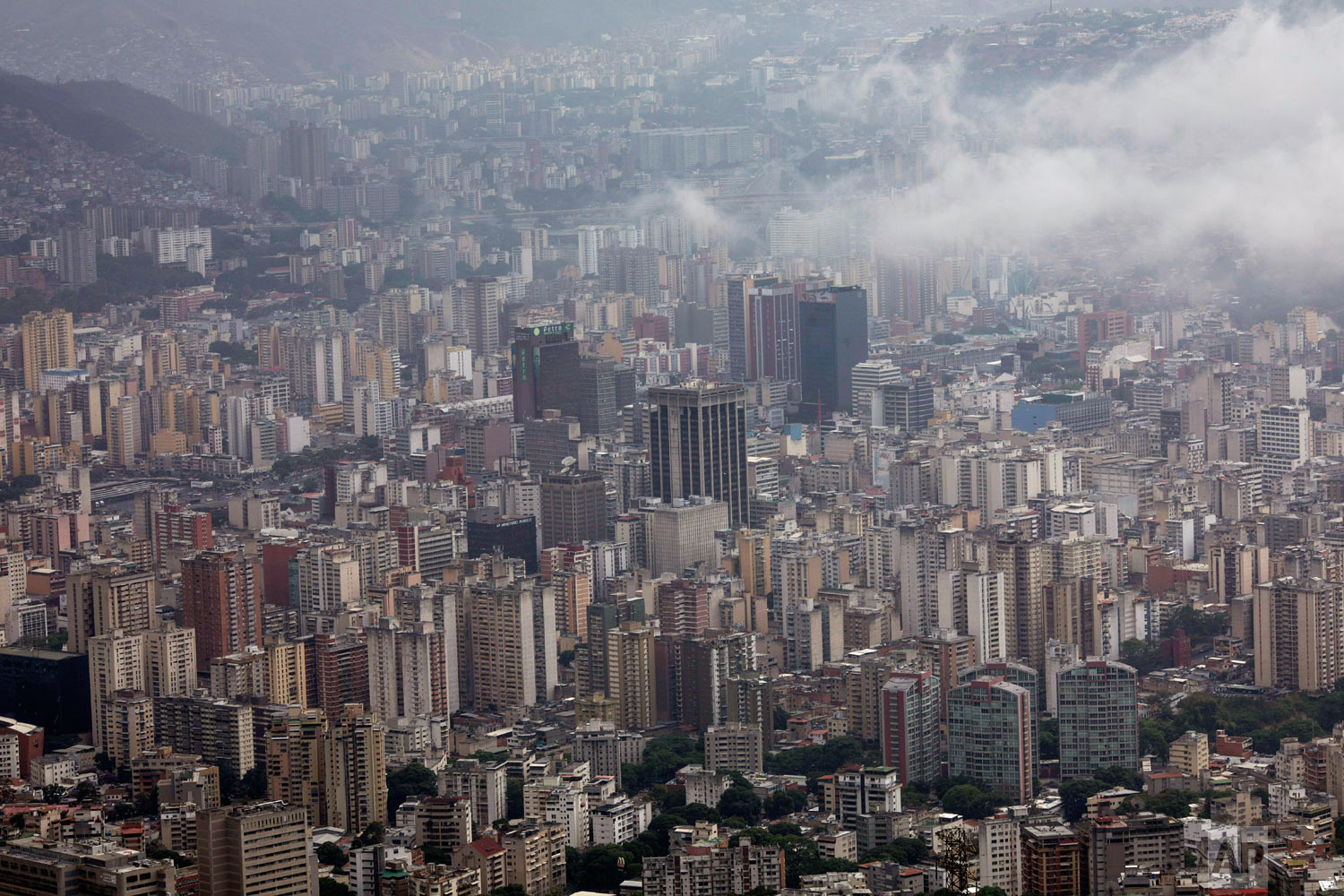 A view of Caracas, Venezuela, seen from the cable car that takes visitors to the top of La Avila National Park, Saturday, May 11, 2019. (AP Photo/Rodrigo Abd)