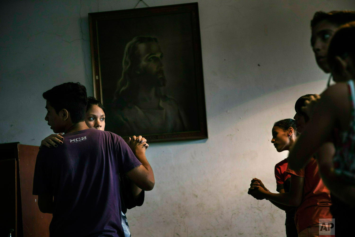 Children participate in a dance class in a parish house in the Petare shanty town, in Caracas, Venezuela, Friday, May 3, 2019.  (AP Photo/Rodrigo Abd)