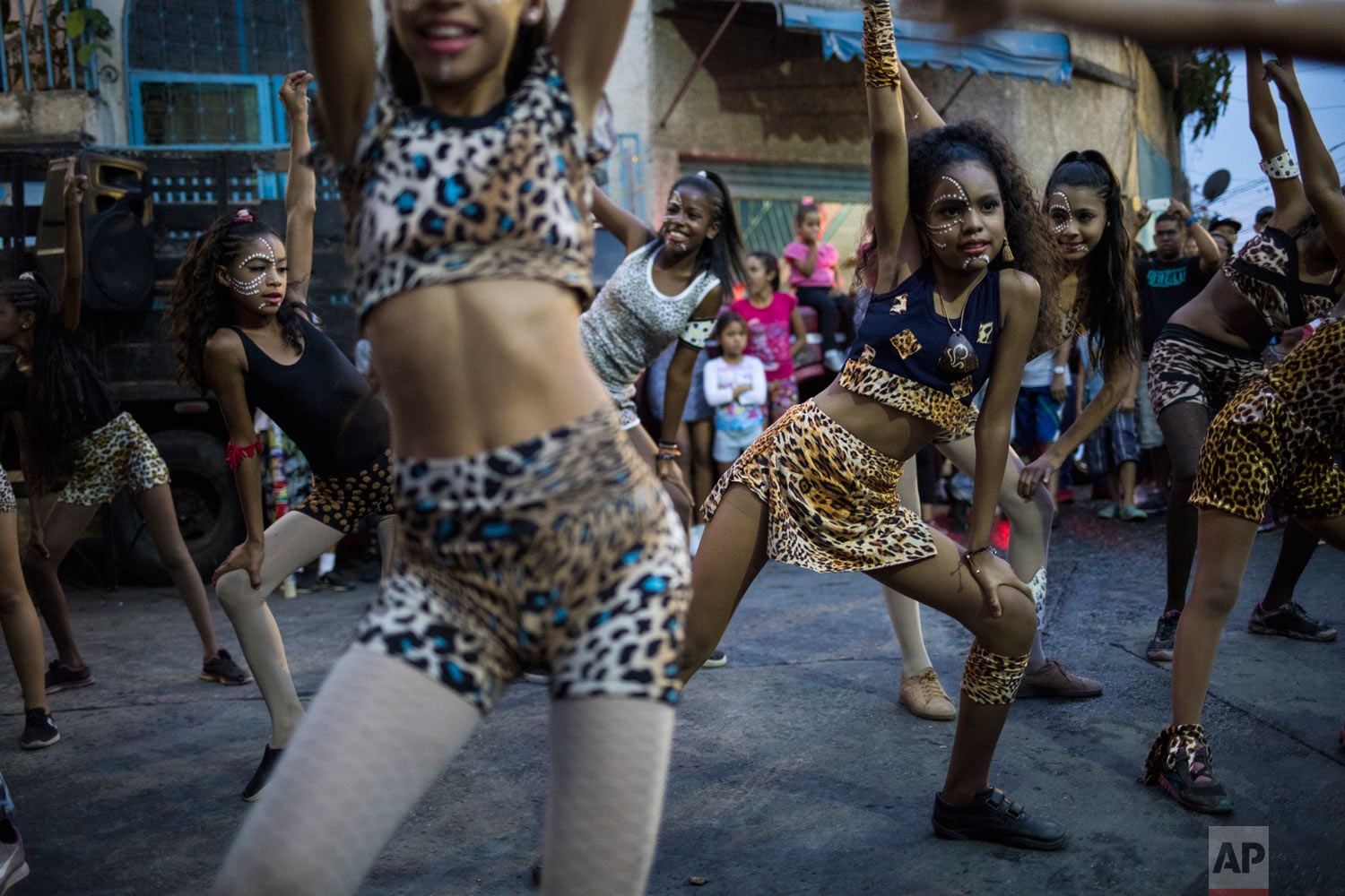 Young dancers from the Style Dance Academy perform during a Mother's Day block party in Caracas, Venezuela, Sunday, May 19, 2019.  (AP Photo/Rodrigo Abd)