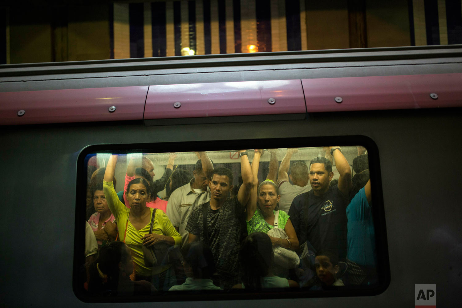 People commute in the subway in Caracas, Venezuela, Friday, May 10, 2019. More than 3 million Venezuelans have left their homeland in recent years amid skyrocketing inflation and shortages of food and medicine. U.S. administration officials have warned that 2 million more are expected to flee by the end of the year if the crisis continues in the oil-rich nation. (AP Photo/Rodrigo Abd)