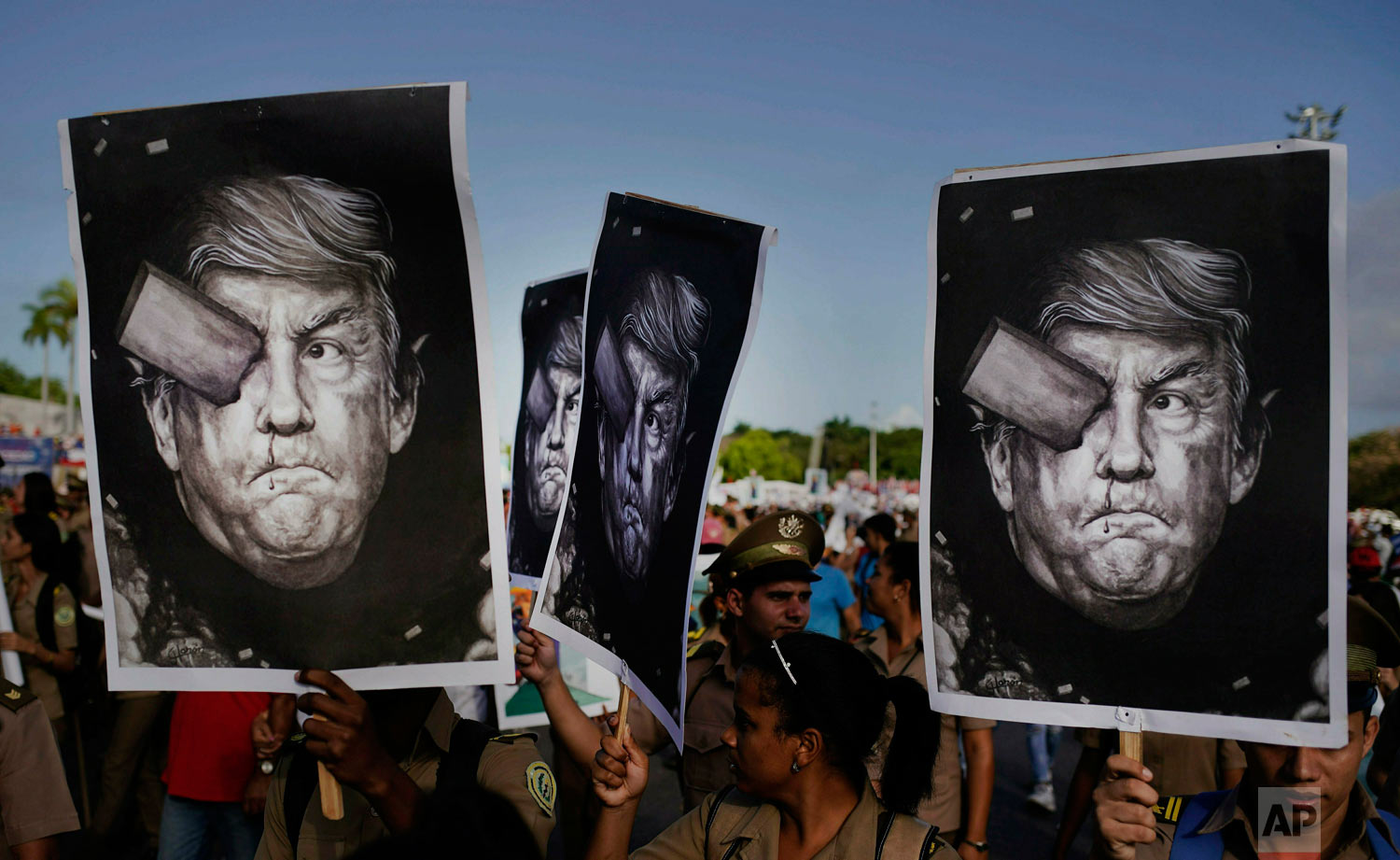 "In this May 1, 2019 photo, Cuban soldiers carry depictions of President Donald Trump at the May Day parade in Revolution Square in Havana, Cuba. Trump claimed via Twitter that if Cuban troops and militia do not cease their operations in support of Venezuela immediately, Cuba would suffer ""a full and complete embargo"" as well as ""highest-level sanctions."" (AP Photo/Ramon Espinosa)"