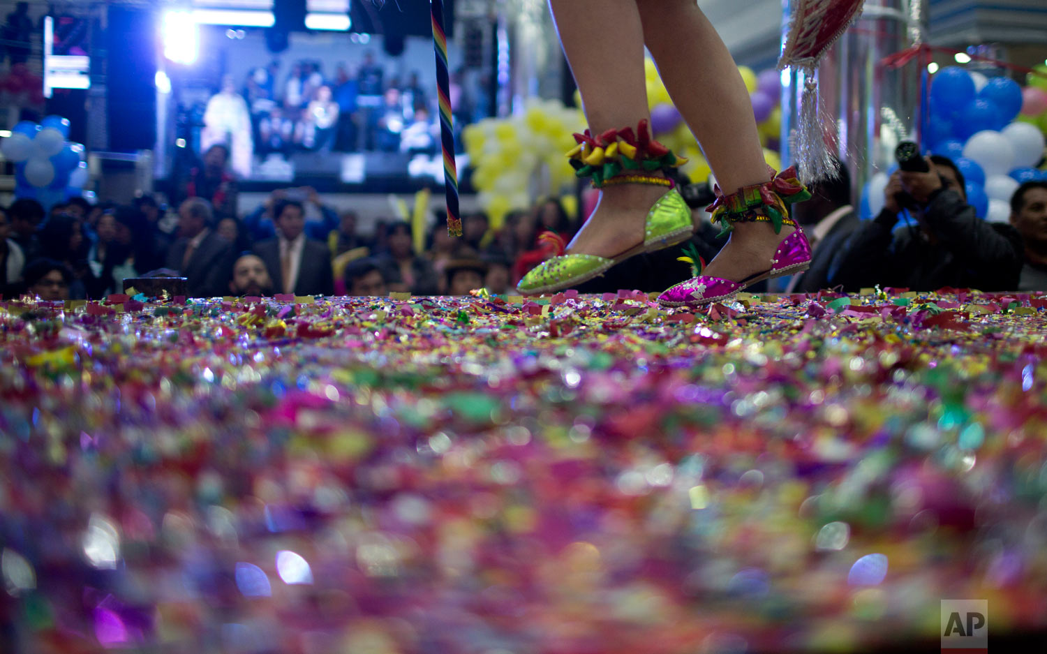 A contestant competes on stage blanketed in confetti in the Queen of Great Power contest in La Paz, Bolivia, Friday, May 24, 2019. The largest religious festival in the Andes choses its queen in a tight contest to head the Festival of the Lord Jesus of the Great Power, mobilizing dancers and musicians. (AP Photo/Juan Karita)