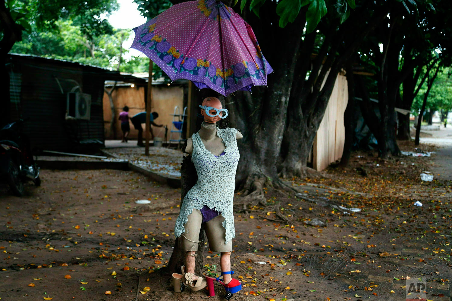 "A dressed up mannequin dubbed ""Miss Evacuated"" placed there by an evacuee stands outside a shelter in Asuncion, Paraguay, Tuesday, May 7, 2019, for people who were forced to evacuate their homes due to flooding caused by heavy rains. (AP Photo/Jorge Saenz)"