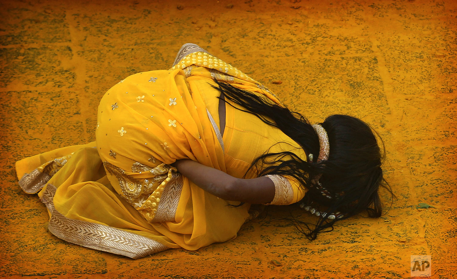 A devotee covered in the spice turmeric goes into a trance during the celebration of the Bhandara Festival, or the Festival of Turmeric, at the Jejuri temple in Pune district, Maharashtra state, India, Monday, June 3, 2019. (AP Photo/Rafiq Maqbool)