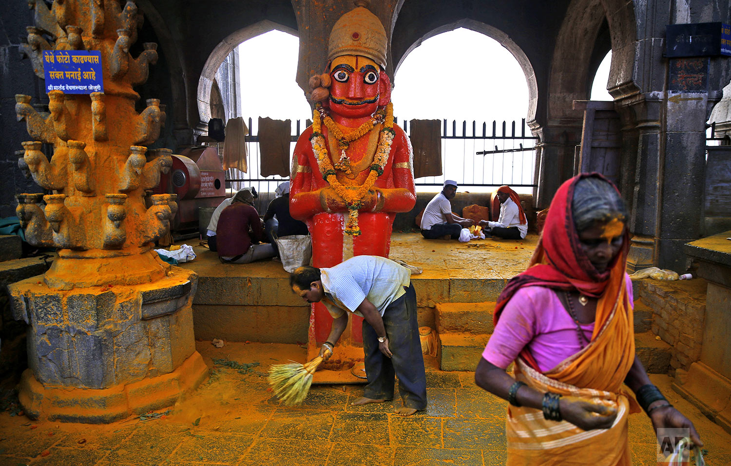 A devotees sweeps before the celebration of the Bhandara Festival, or the Festival of Turmeric, at the Jejuri temple in Pune district, Maharashtra state, India, Monday, June 3, 2019. (AP Photo/Rafiq Maqbool)