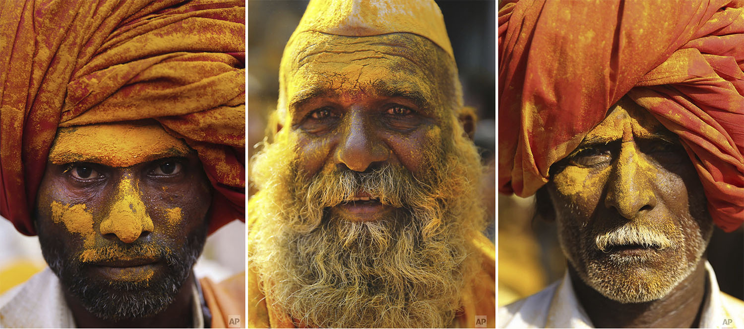 Devotees are covered in the spice turmeric during the celebration of the Bhandara Festival, or the Festival of Turmeric, at the Jejuri temple in Pune district, Maharashtra state, India, Monday, June 3, 2019. (AP Photo/Rafiq Maqbool)