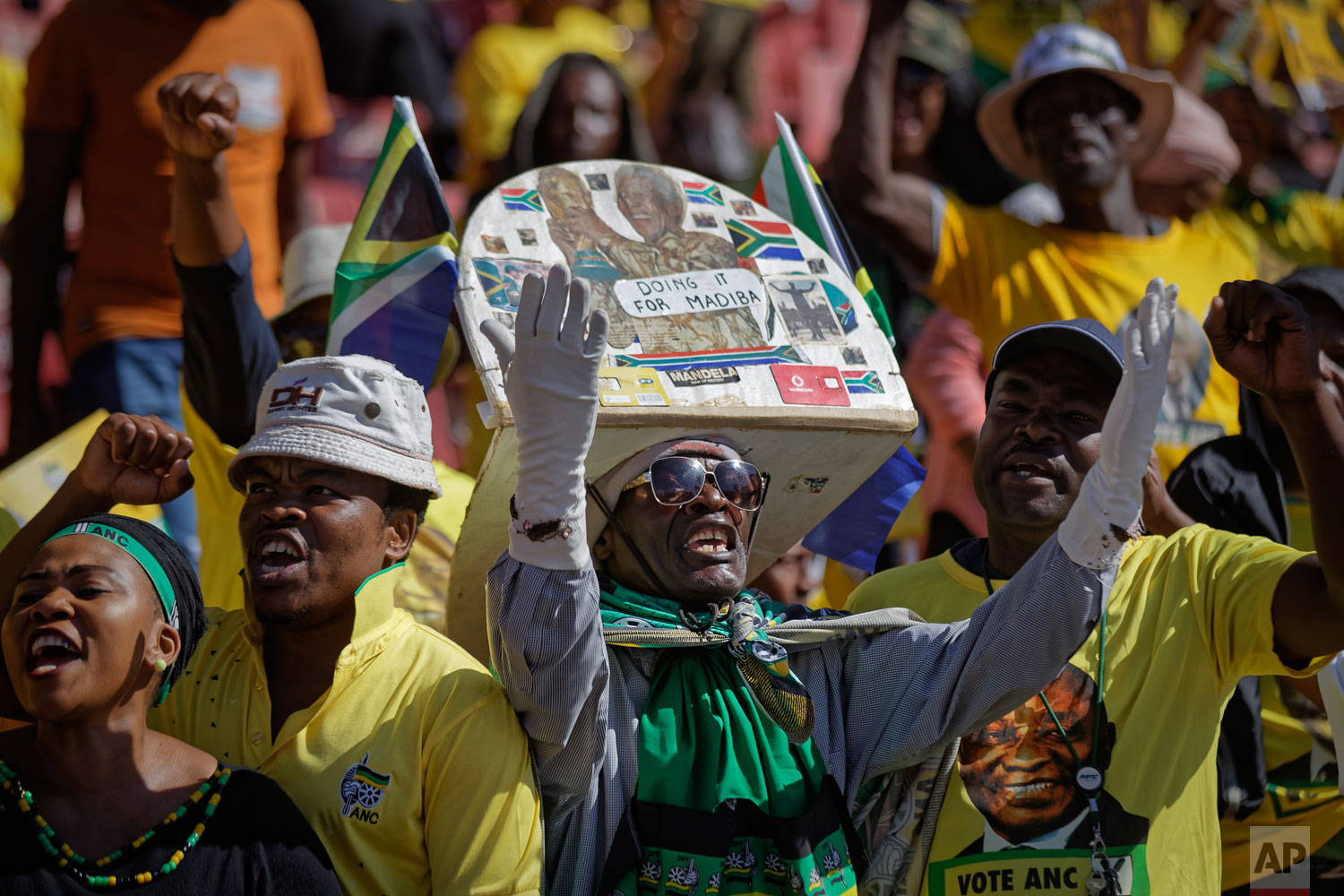 "A supporter of the ruling African National Congress (ANC) wears a hat referring to former President Nelson Mandela by his nickname ""Madiba"", at the party's final election rally at Ellis Park stadium in Johannesburg, South Africa Sunday, May 5, 2019. (AP Photo/Ben Curtis)"