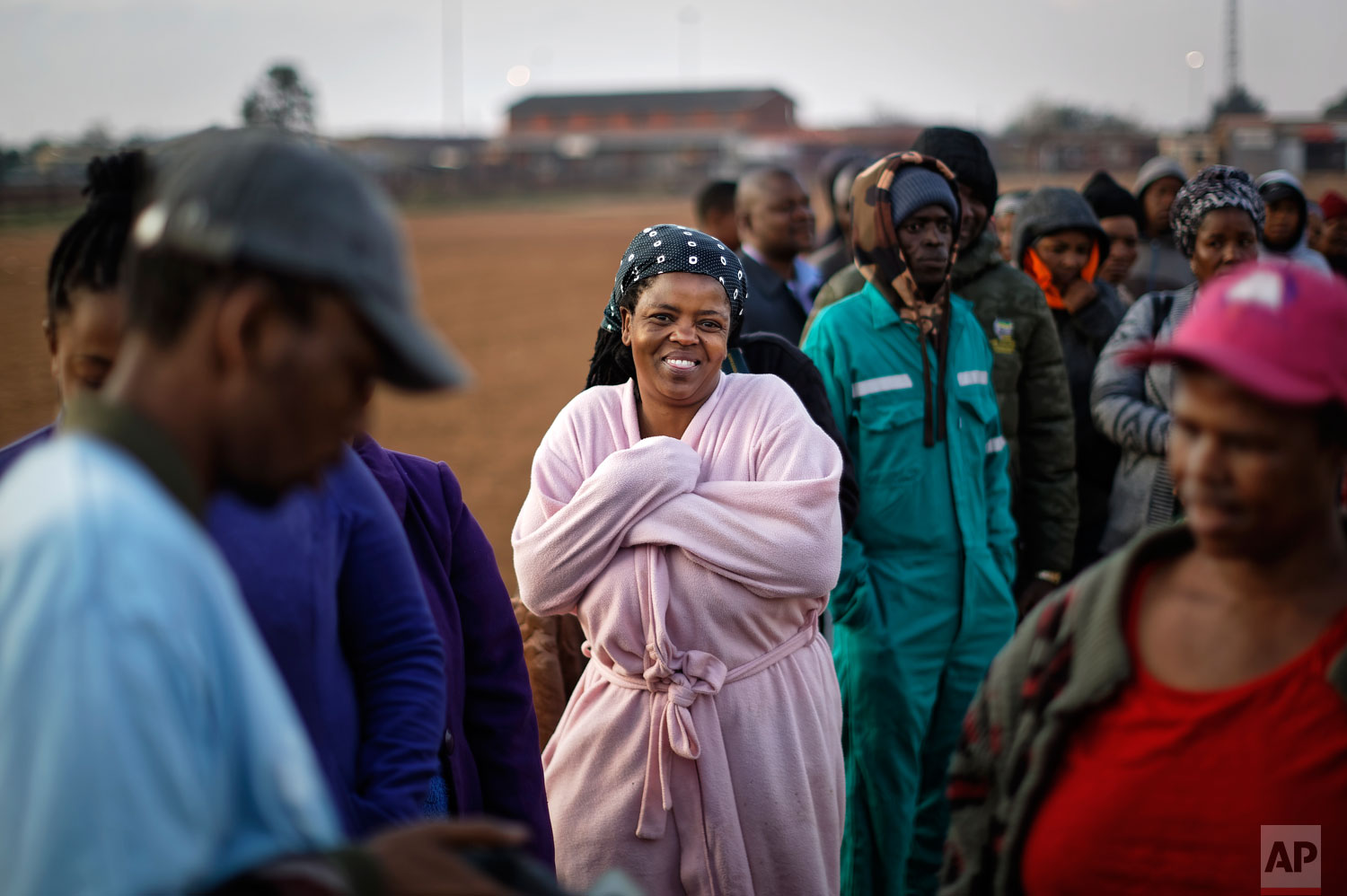 South Africans queue in the early morning cold to cast their votes in the mining settlement of Bekkersdal, west of Johannesburg, in South Africa Wednesday, May 8, 2019.  (AP Photo/Ben Curtis)