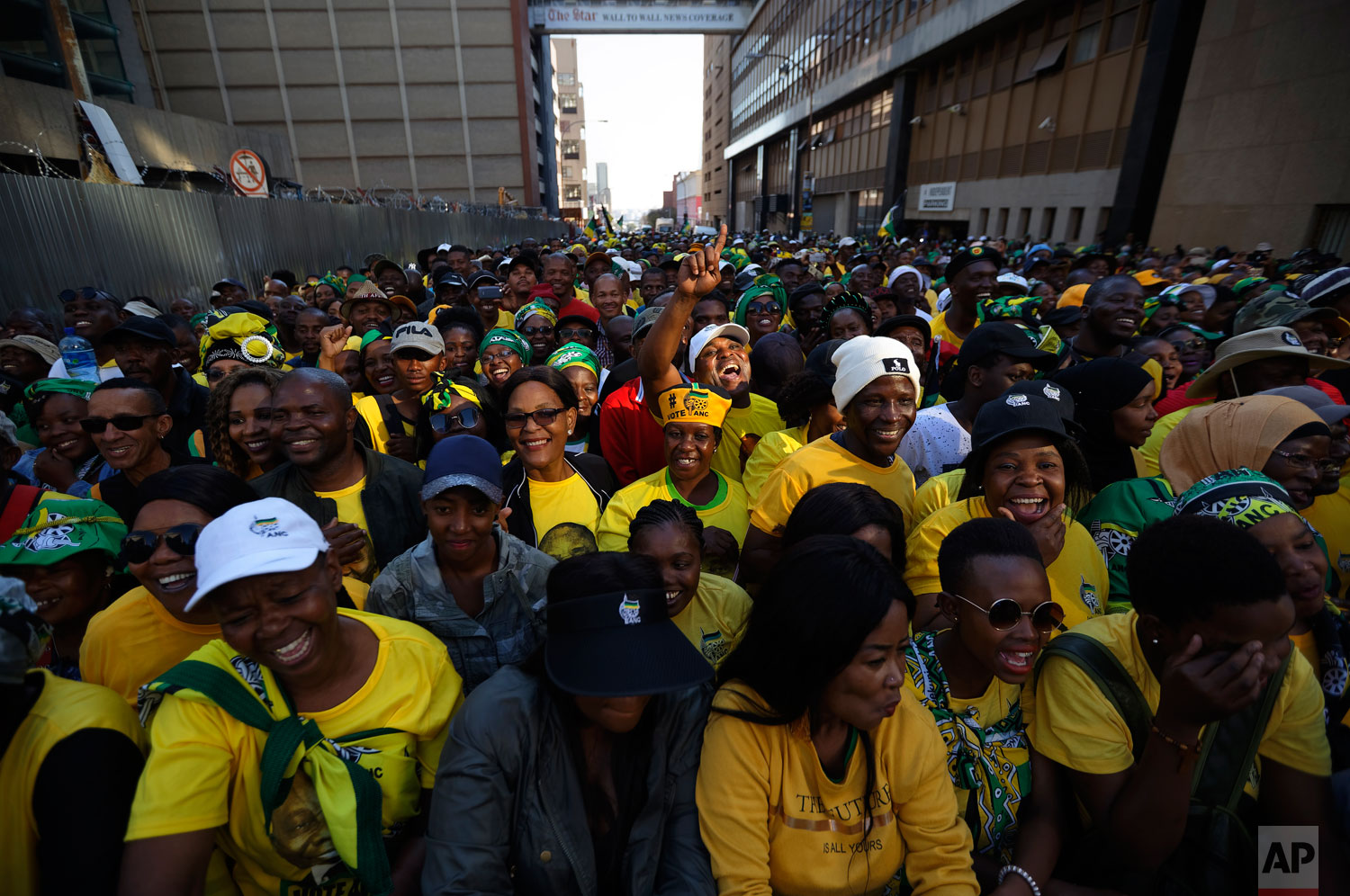 Supporters of the African National Congress (ANC) party cheer during a victory rally in downtown Johannesburg, South Africa Sunday, May 12, 2019.  (AP Photo/Ben Curtis)