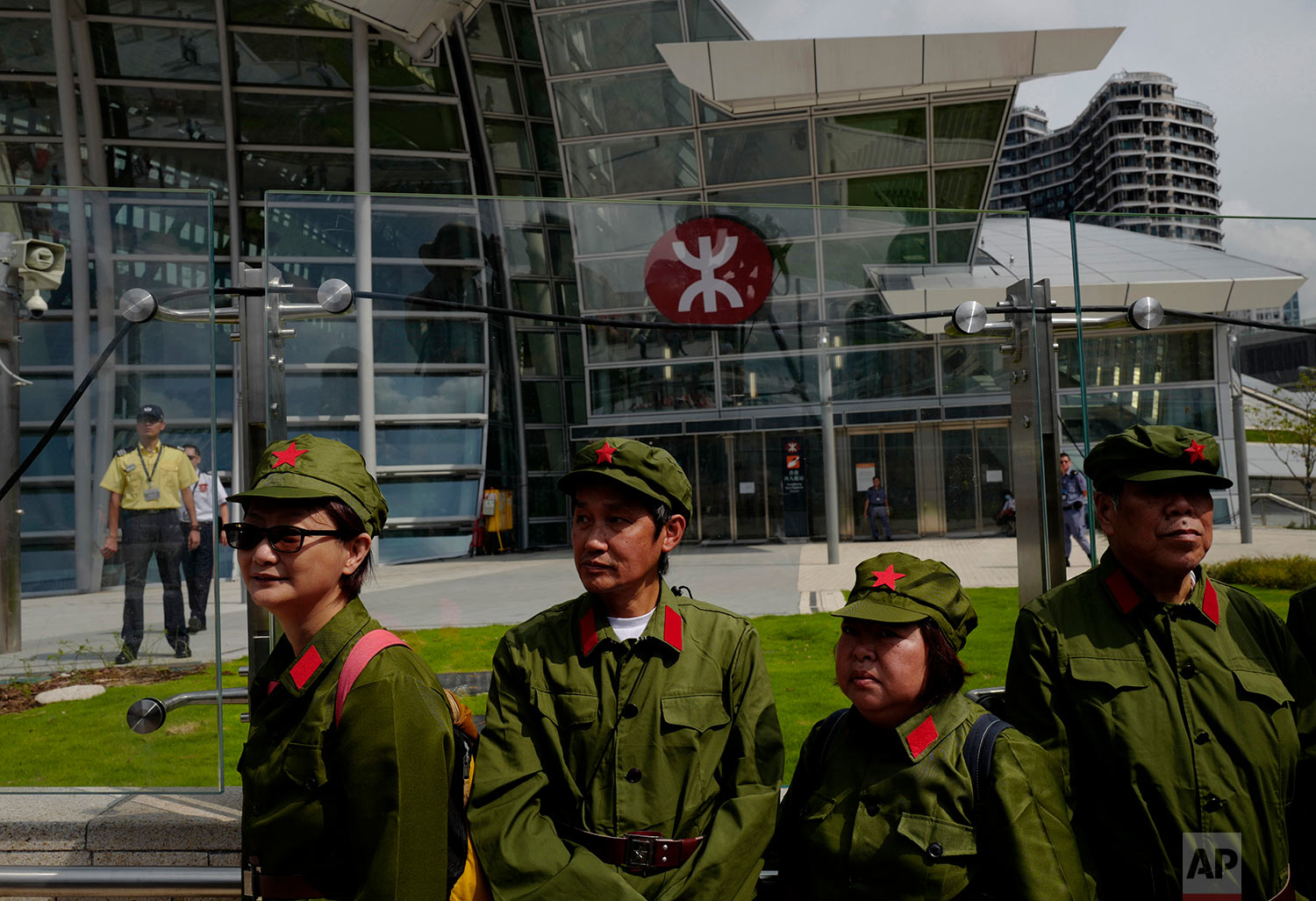 Protesters dress as People's Liberation Army (PLA) during a protest outside the Western Kowloon Station against the opening ceremony of the Hong Kong Express Rail Link in Hong Kong, Sept. 22, 2018. (AP Photo/Vincent Yu)