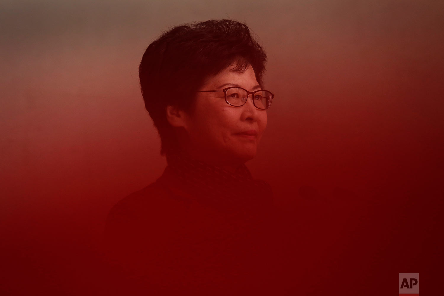 Hong Kong's chief executive-elect Carrie Lam stands in front of reporters at government headquarter in Hong Kong, March 27, 2017. (AP Photo/Vincent Yu)