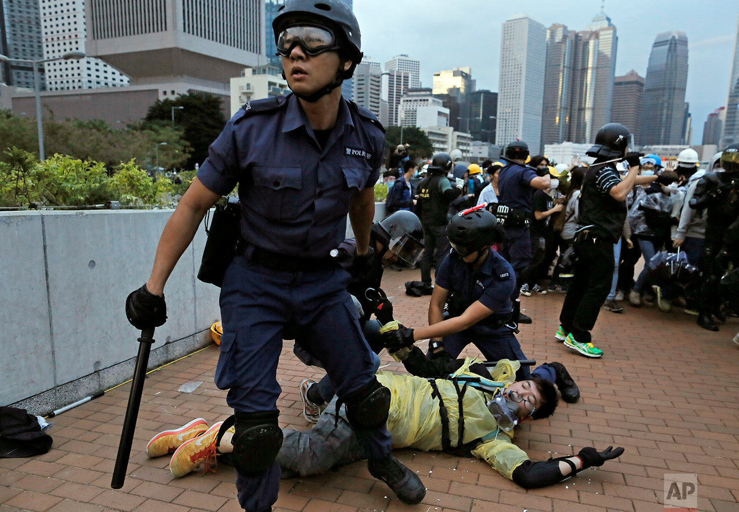 A protester is arrested by police officers outside government headquarters in Hong Kong, Dec. 1, 2014. (AP Photo/Vincent Yu)