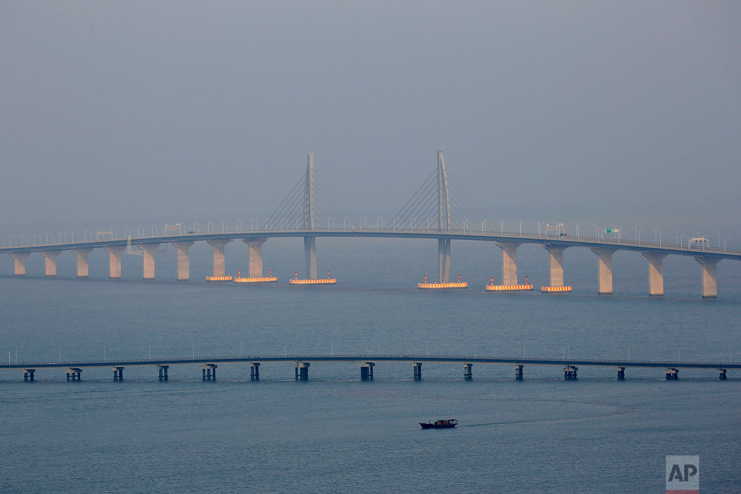 The Hong Kong-Zhuhai-Macau Bridgeis seen during the first day operation of the world's longest cross-sea project, which has a total length of 55 kilometers (34 miles), in Macau, Oct. 24, 2018. (AP Photo/Kin Cheung)