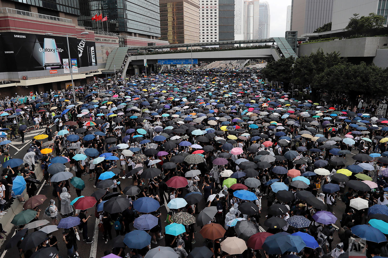 Protestors gather near the Legislative Council in Hong Kong, June 12, 2019. (AP Photo/Kin Cheung)