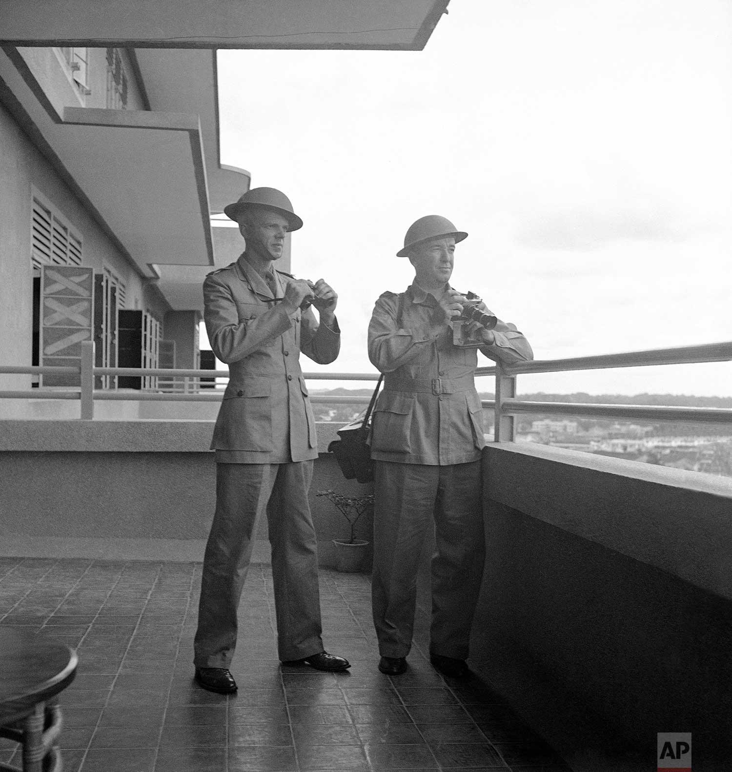 "C. Yates McDaniel, left, and Frank ""Pappy"" Noel, April 22, 1942. (AP Photo/Frank Noel)"