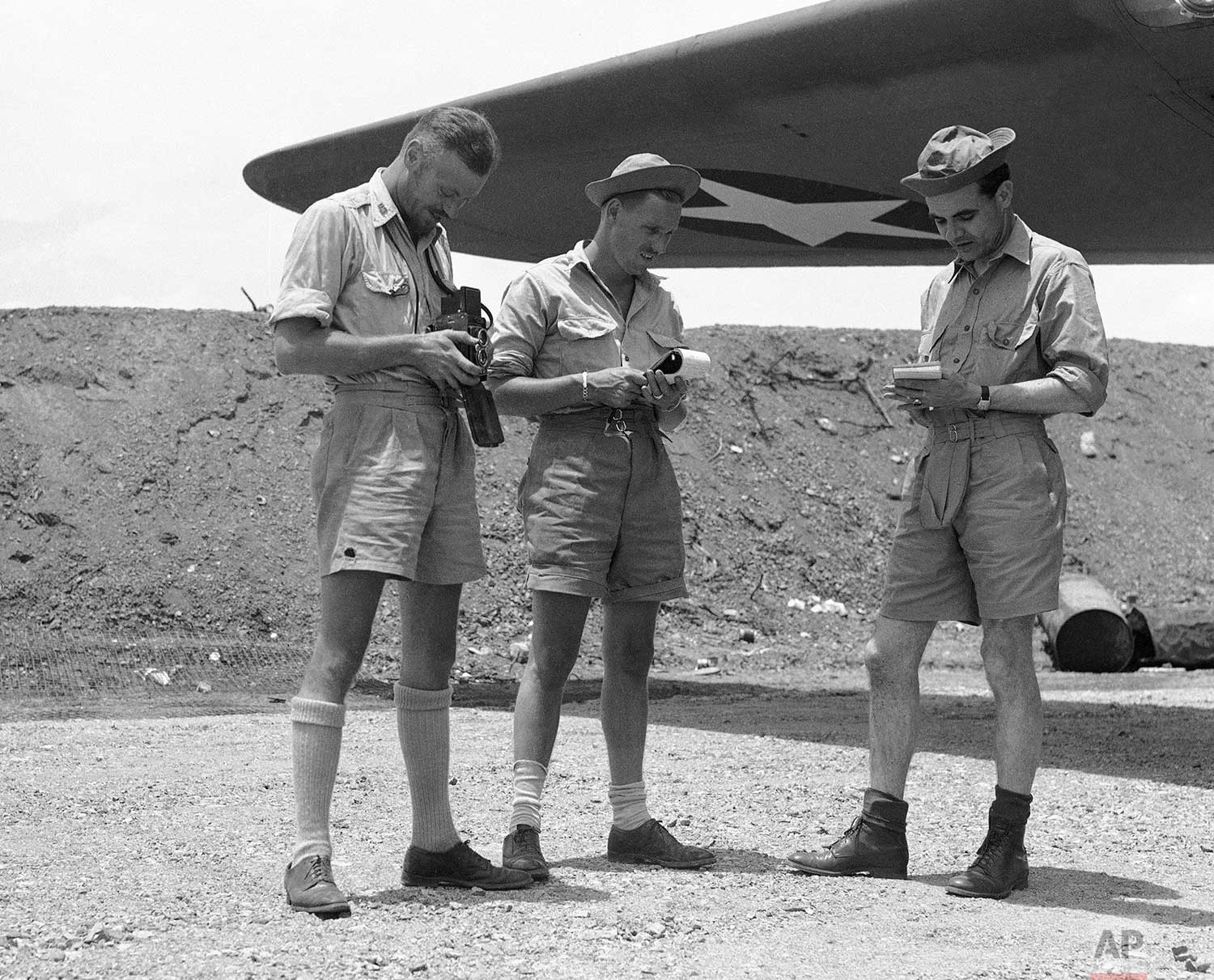 From left, Ed Widdis, Associated Press photographer; Dean Schedler, Associated Press writer and Murlin Spencer, Associated Press writer. These are the men on the job covering the news for The AP in New Guinea, Nov. 23, 1942. (AP Photo/Ed Widdis)