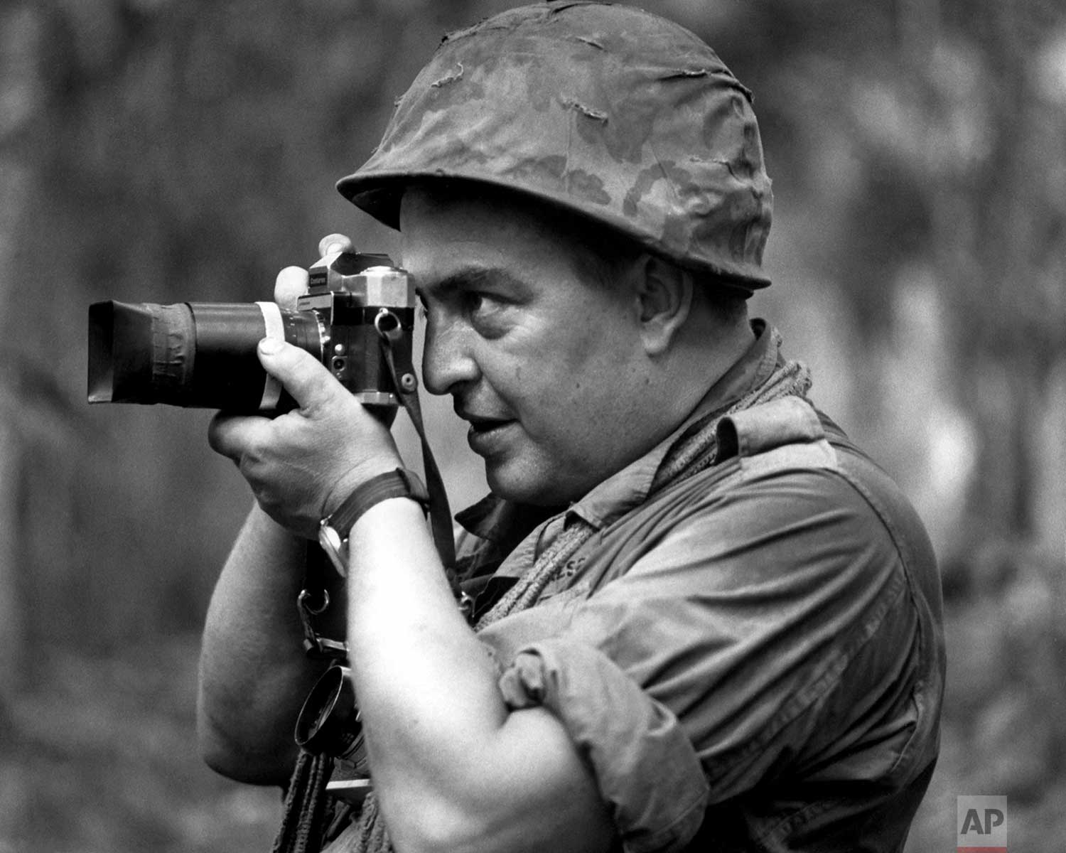 In this 1967 photo, Associated Press photographer Horst Faas works in Vietnam. Faas, a prize-winning combat photographer carved out new standards for covering war with a camera and became one of the world's legendary photojournalists in nearly half a century with The Associated Press. (AP Photo/Courtesy AP Corporate Archives)