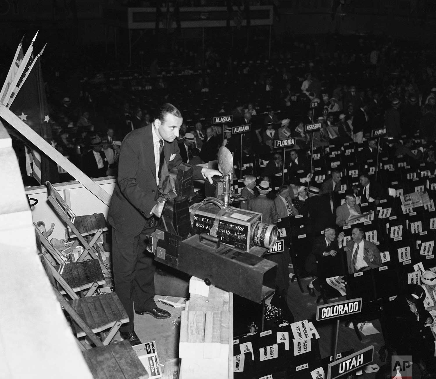 Associated Press photographer Murray Becker of New York takes a general view picture of the scene at the 1936 Republican National Convention in Cleveland, Ohio in the Public Auditorium, using a 28-inch camera, June 1936. (AP Photo)