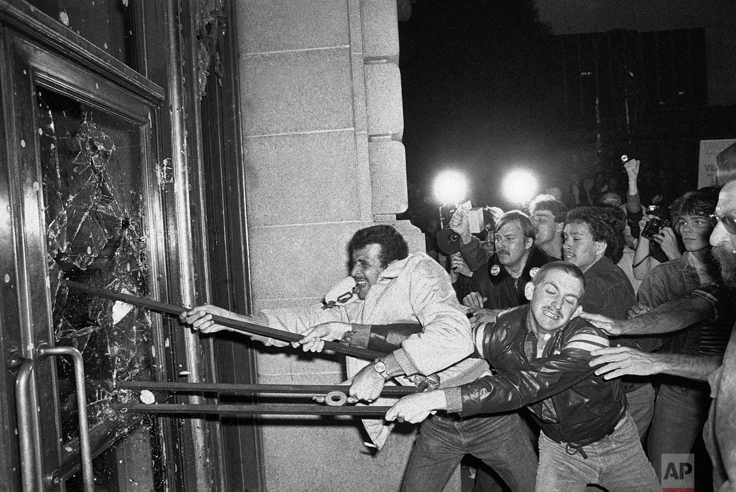 In this May 22, 1979 file photo, demonstrators smash glass out of the front doors of the San Francisco City Hall. Thousands marched from the city's gay community to city hall, protesting the voluntary manslaughter conviction of Dan White in the fatal shootings of Mayor George Moscone and city supervisor and gay rights activist Harvey Milk. (AP Photo/Paul Sakuma)