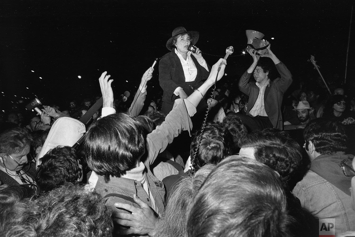 In this Wednesday, June 8, 1977 file photo, former U.S. Rep. Bella Abzug addresses a rally in New York as thousands turn out to protest the repeal of a homosexual rights law in Dade County, Fla. Abzug, a candidate for mayor in New York, urged gay rights activists to undertake a public education program to gain their rights. (AP Photo/Suzanne Vlamis)