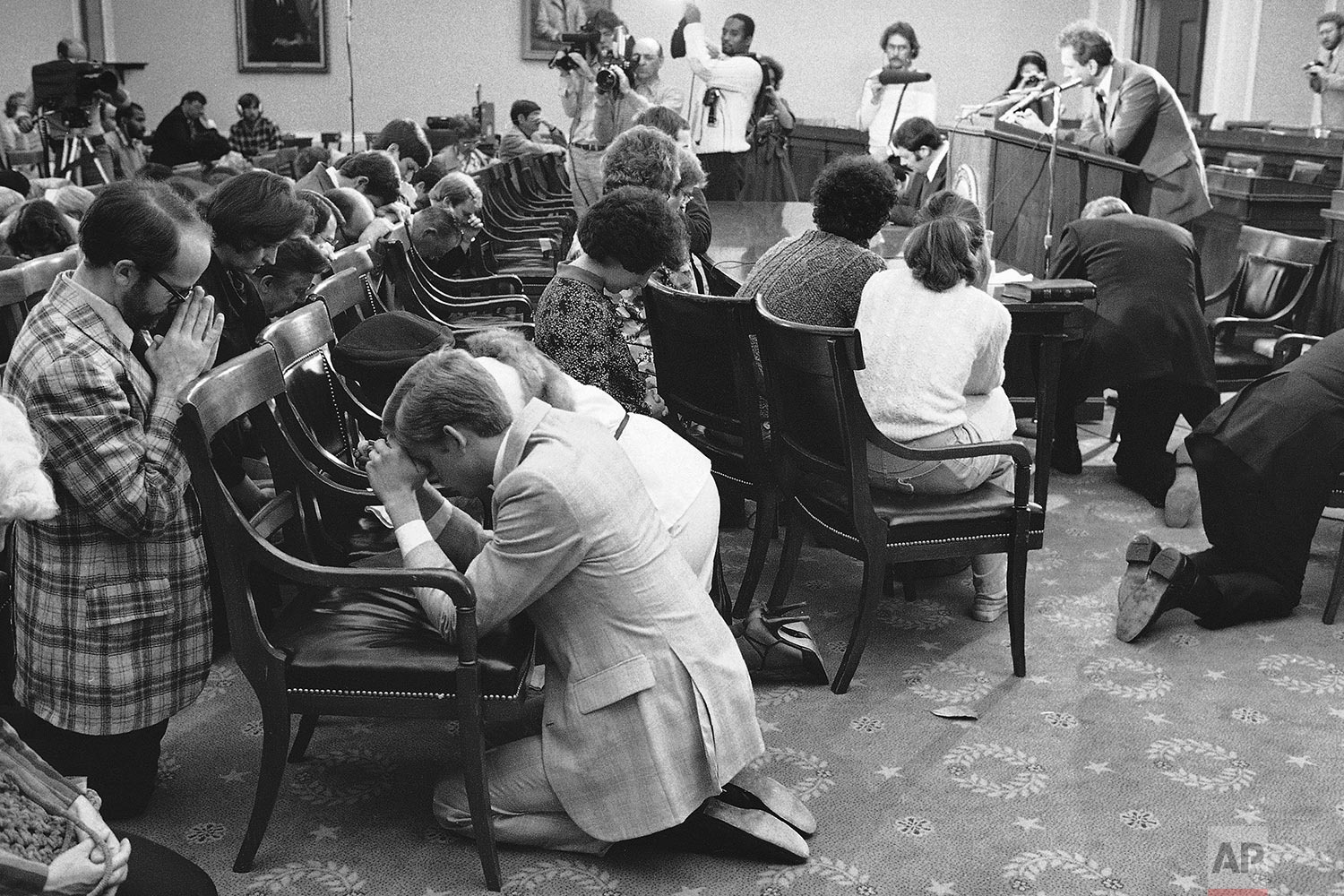"""In this Sunday, Oct. 14, 1979 file photo, a group calling themselves the """"Ad-Hoc Committee for the National Day of Prayer on Homosexuality"""" are led in prayer by Paul Cates at a gathering on Capitol Hill in Washington. The group stated they intended to pray for the repentance of homosexuals. The gathering coincided with a Washington rally by gay organizations. (AP Photo/Thumma)"""