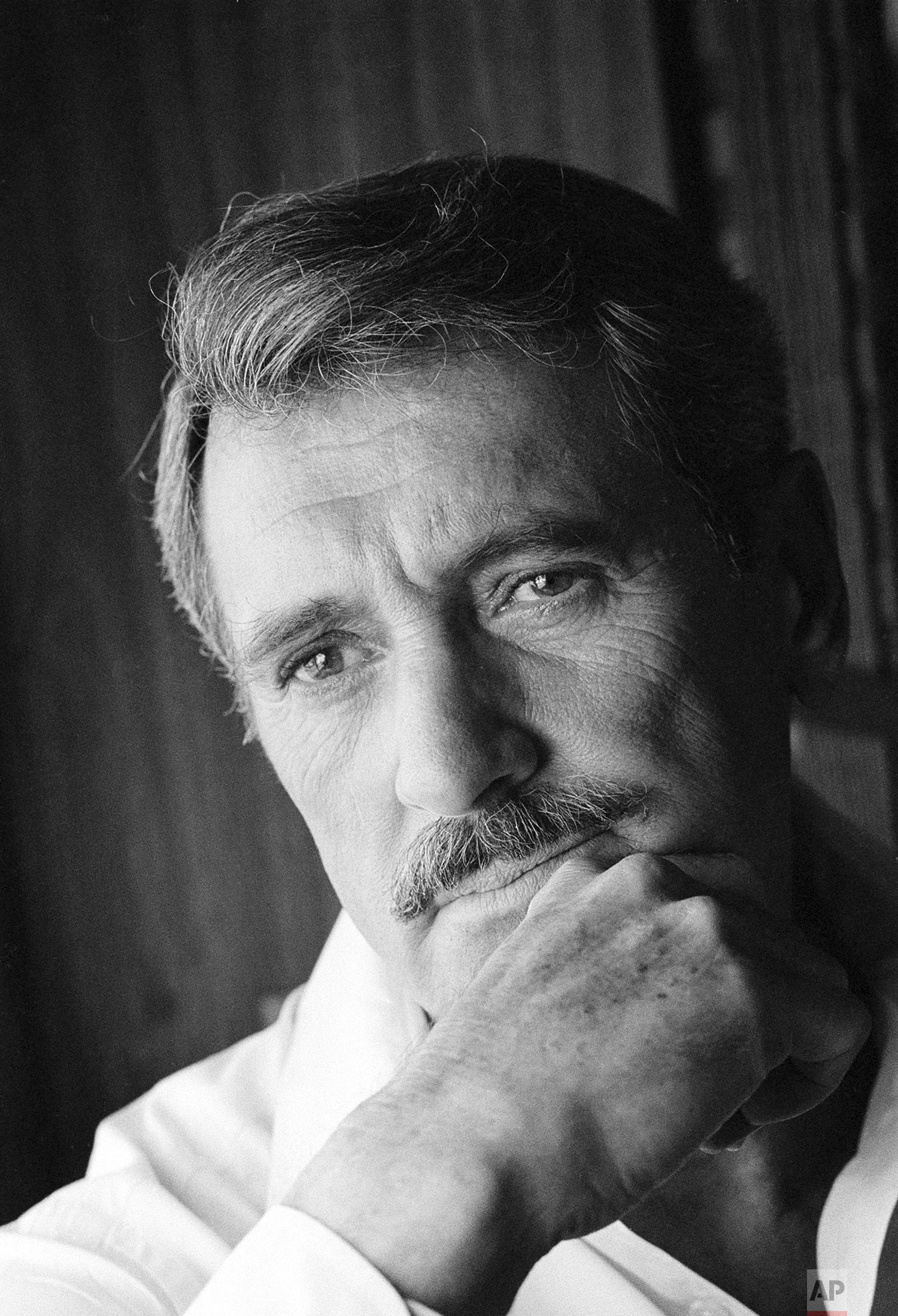 In this August 1982 file photo, actor Rock Hudson poses for a portrait in Los Angeles, Calif. The 1980s proved shattering _ but also galvanizing _ for gay Americans, as an initially mysterious, unnamed disease morphed into the AIDS epidemic. Many thousands of gay men died, including Hudson; his death played a major role in raising public awareness of the disease. (AP Photo/Lennox McLendon)