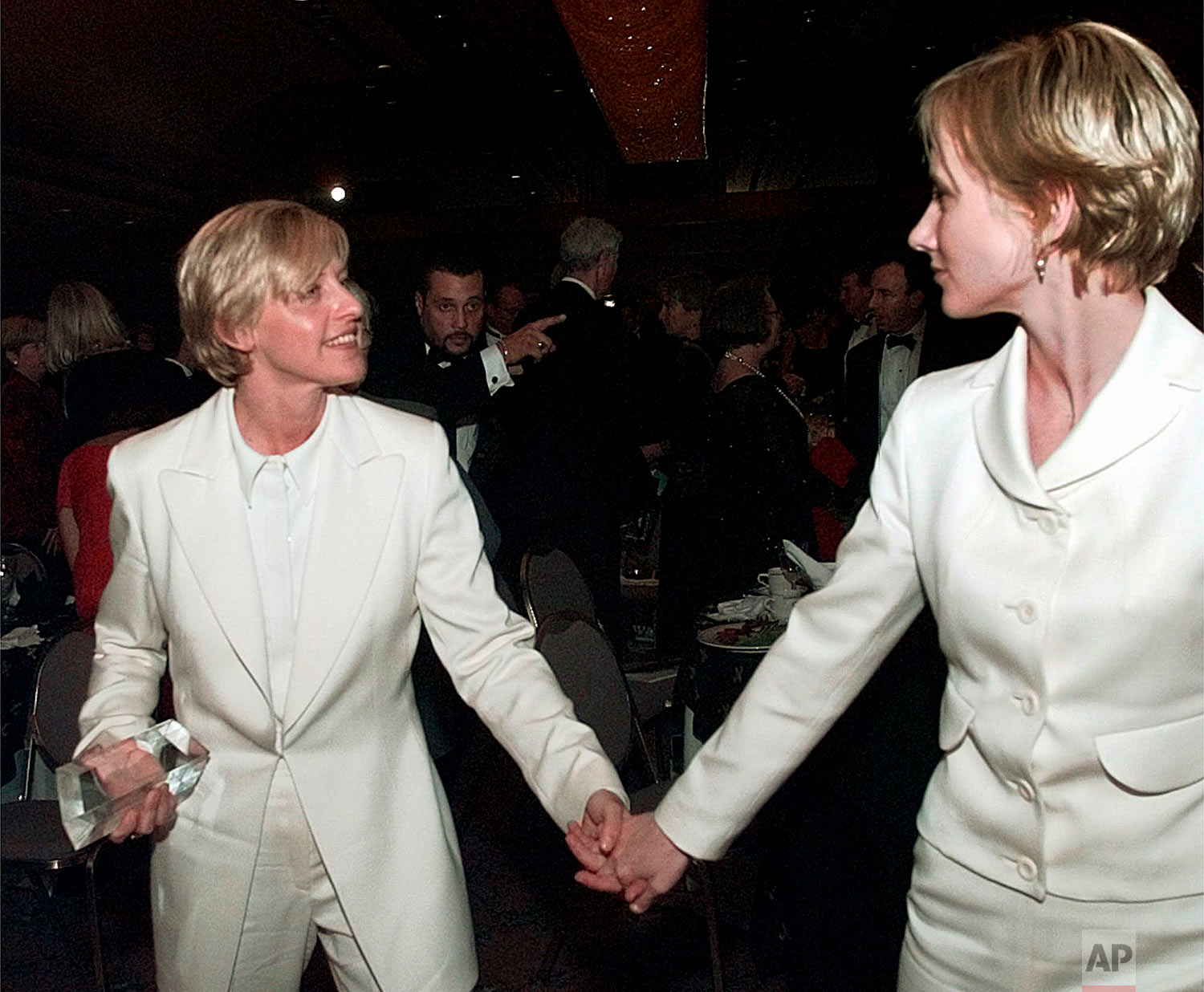 In this Saturday, Nov. 8, 1997 file photo, actress Ellen DeGeneres, left, and her companion, Anne Heche, leave the Human Rights Campaign national dinner in Washington after DeGeneres received her civil rights award. President Clinton spoke earlier at the dinner, before the nation's largest lesbian and male homosexual group--the first president to appear before such an audience. (AP Photo/Brian K. Diggs)