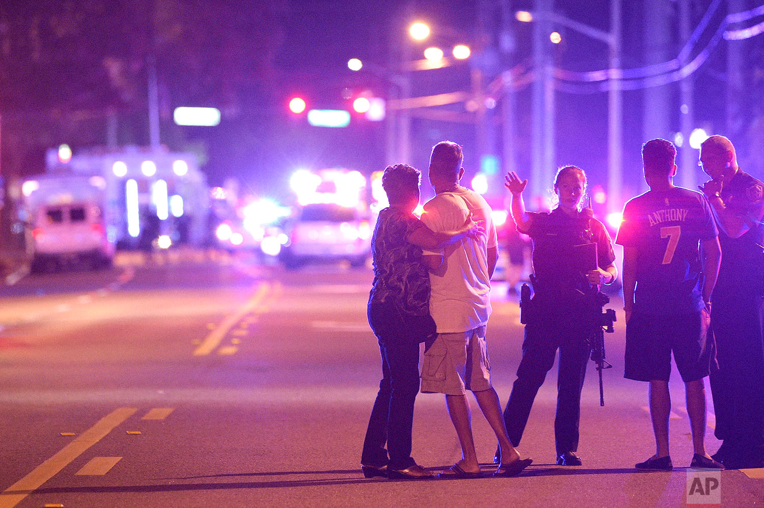 In this Sunday, June 12, 2016 file photo, police officers direct family members away from a fatal shooting at Pulse Orlando nightclub in Orlando, Fla. A gunman massacred 49 people and wounded many others at the gay nightclub. (AP Photo/Phelan M. Ebenhack)