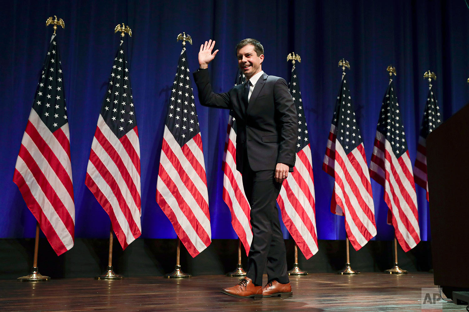 In this Tuesday, June 11, 2019 file photo, Democratic presidential candidate Mayor Pete Buttigieg waves at Indiana University Auditorium in Bloomington, Ind., to speak on foreign policy and national security. (AP Photo/Michael Conroy)