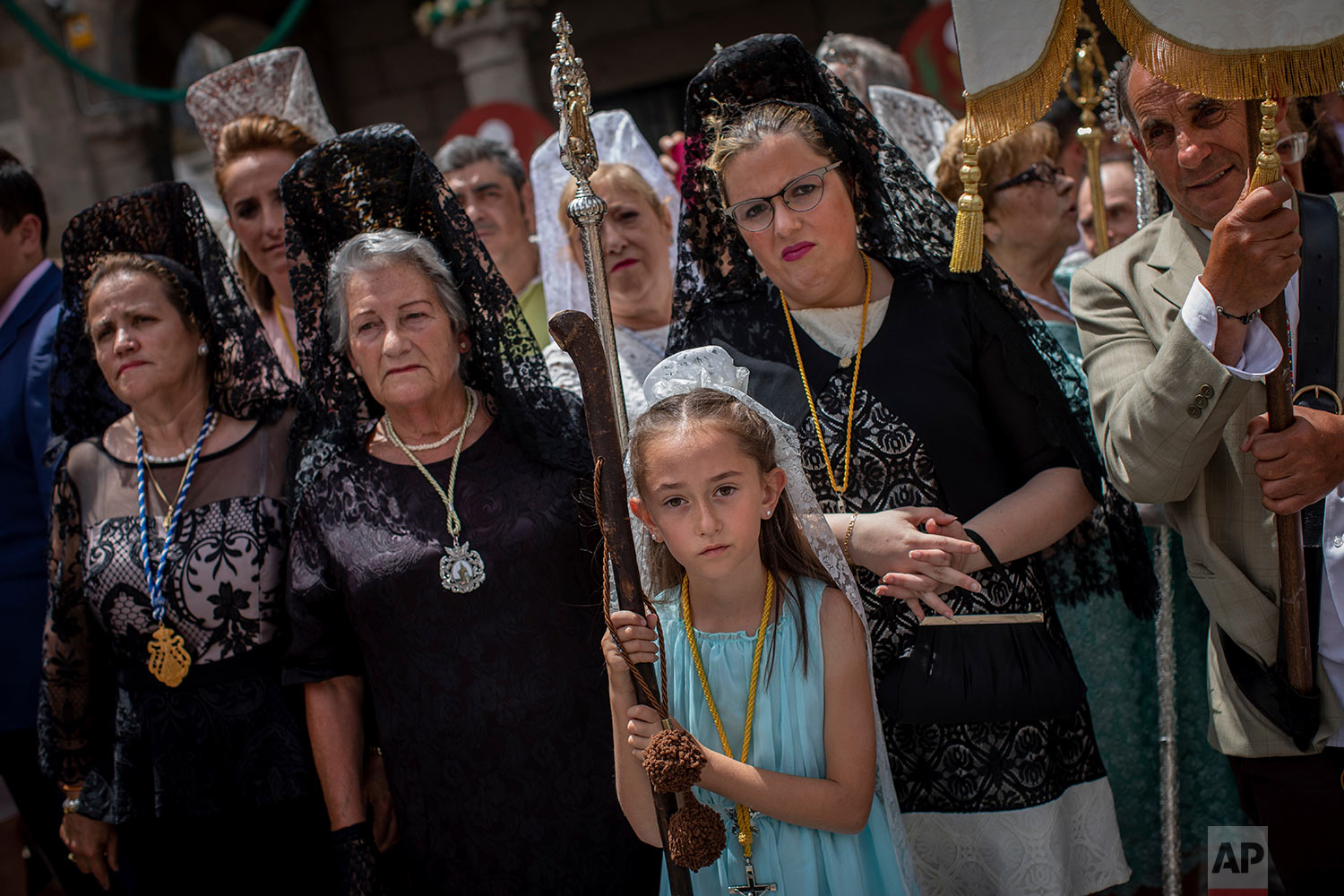 Catholic worshippers take part during the Corpus Christi procession in the village of Bejar, Spain, Sunday, June 23, 2019. (AP Photo/Bernat Armangue)