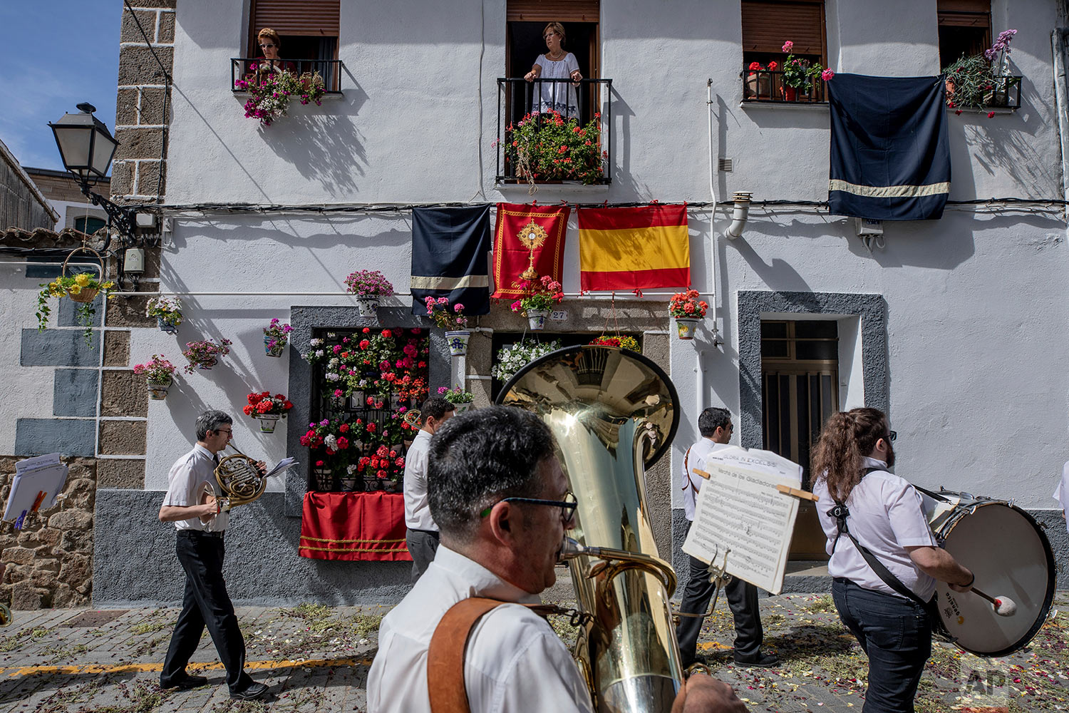 A music band takes part during the Corpus Christi procession in the village of Bejar, Spain, Sunday, June 23, 2019.  (AP Photo/Bernat Armangue)