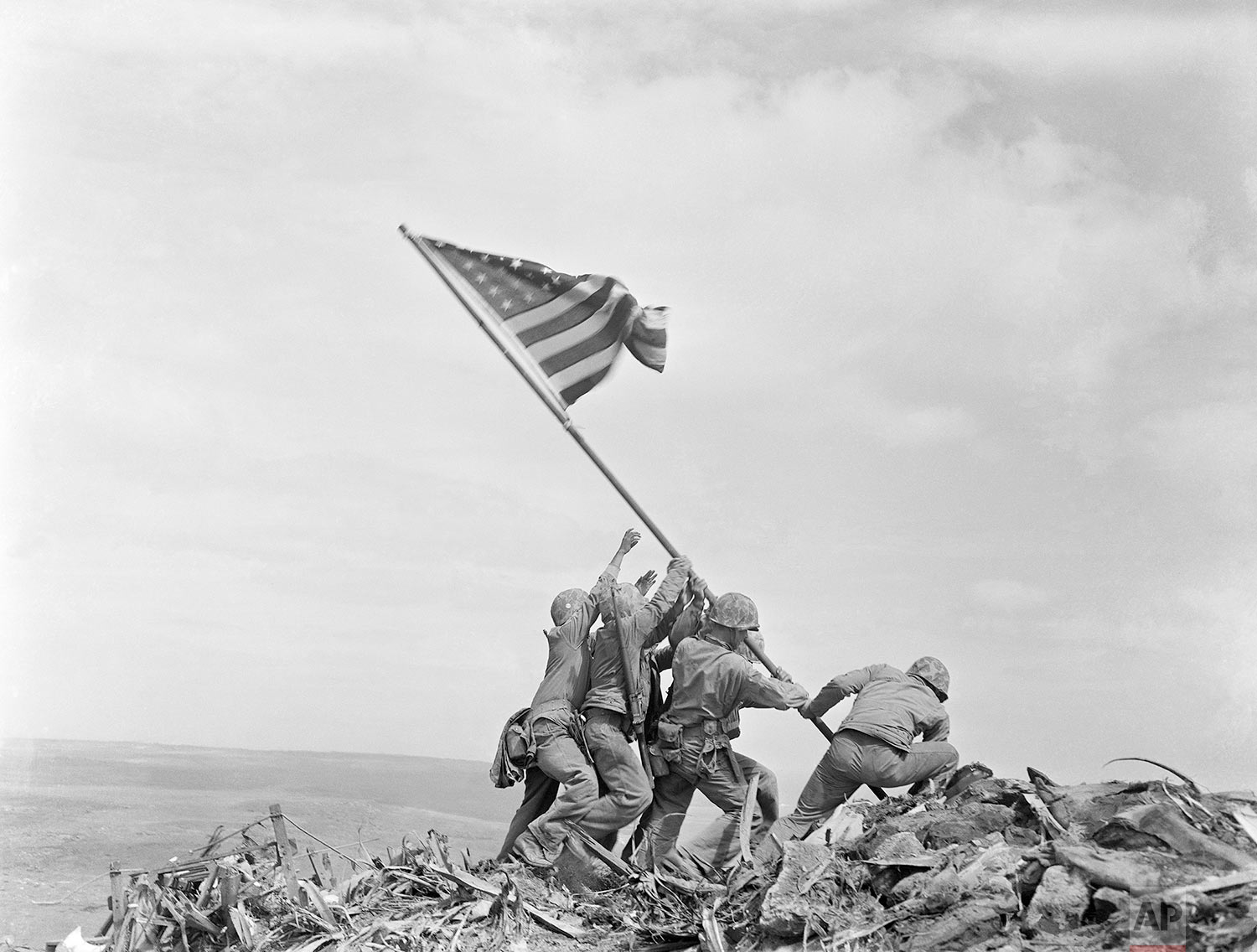 U.S. Marines of the 28th Regiment, 5th Division, raise the American flag atop Mt. Suribachi, Iwo Jima, Japan, Feb 23, 1945. (AP Photo/Joe Rosenthal)