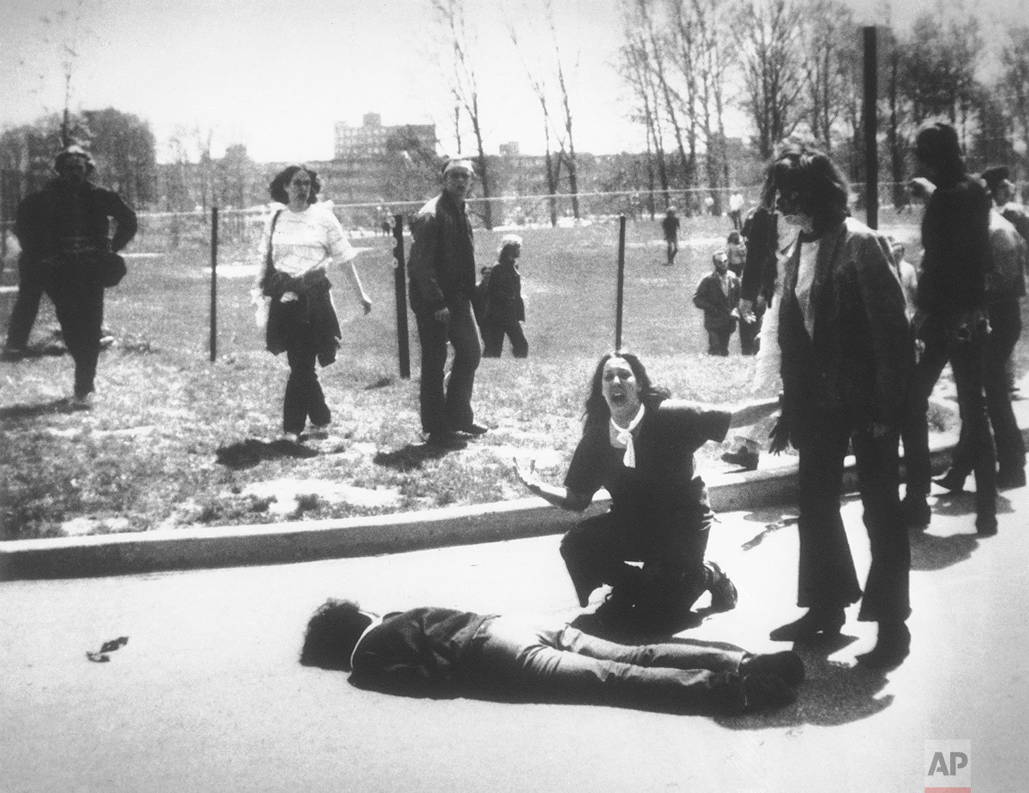 Mary Ann Vecchio cries out as she kneels next to the body of student Jeffrey Miller lying face down on the campus of Kent State University, Kent, Ohio, May 4, 1970. National Guardsmen killed four when they fired into a crowd of demonstrators protesting the U.S. bombing of Cambodia. (AP Photo/John Filo)