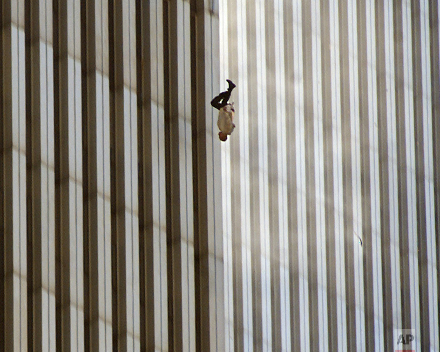 A person falls from the north tower of New York's World Trade Center in this Sept. 11, 2001 photo, after terrorists crashed two hijacked airliners into the World Trade Center and brought down the twin 110-story towers. (AP Photo/Richard Drew)