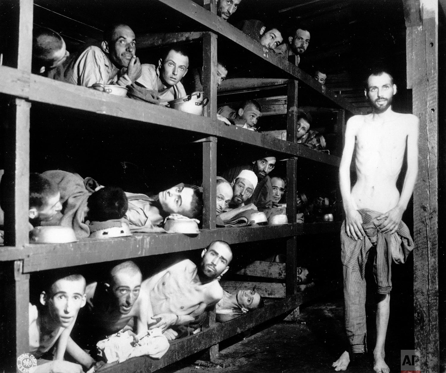 Inmates of the German KZ Buchenwald are seen inside their barracks a few days after U.S troops liberated the concentration camp near Weimar, Germany, April 16, 1945. An estimated 56,000 perished at Buchenwald, most Jews worked to death, shot or hanged by Nazi guards. (AP Photo)