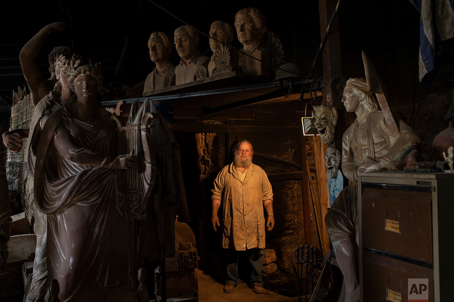 Haralambos Goumas, a 69-year-old sculptor and ceramicist poses for a photo inside his workshop in Athens. (AP Photo/Petros Giannakouris)