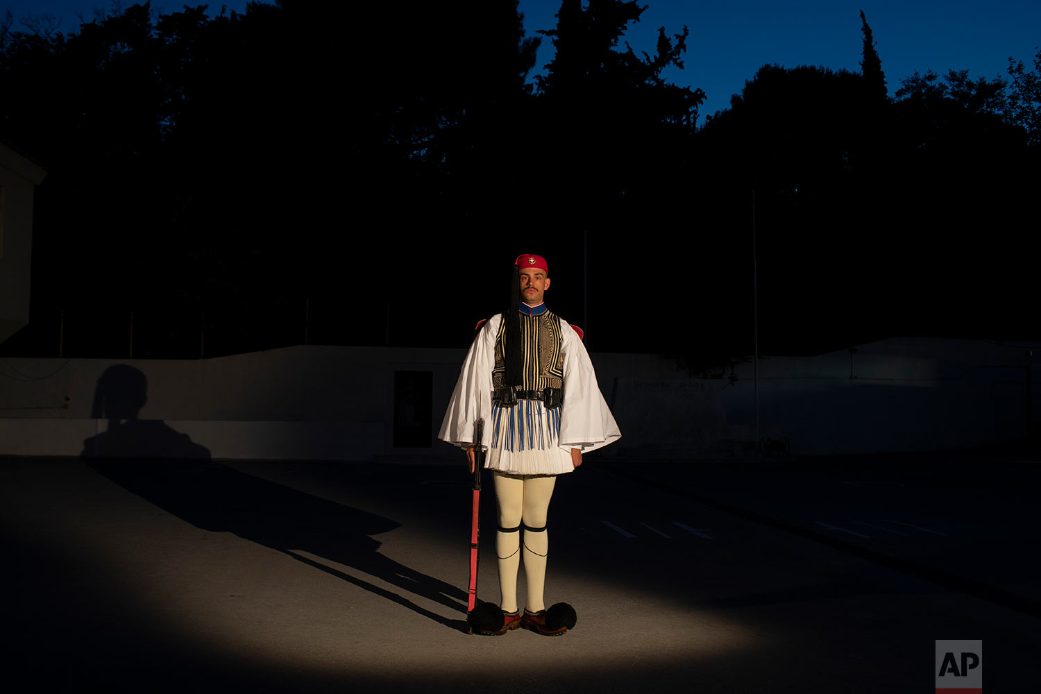 Fragkiskos Koppola, a 24- year-old member of the Presidential Guard poses for a photo inside the Presidential Guards barracks in Athen. (AP Photo/Petros Giannakouris)