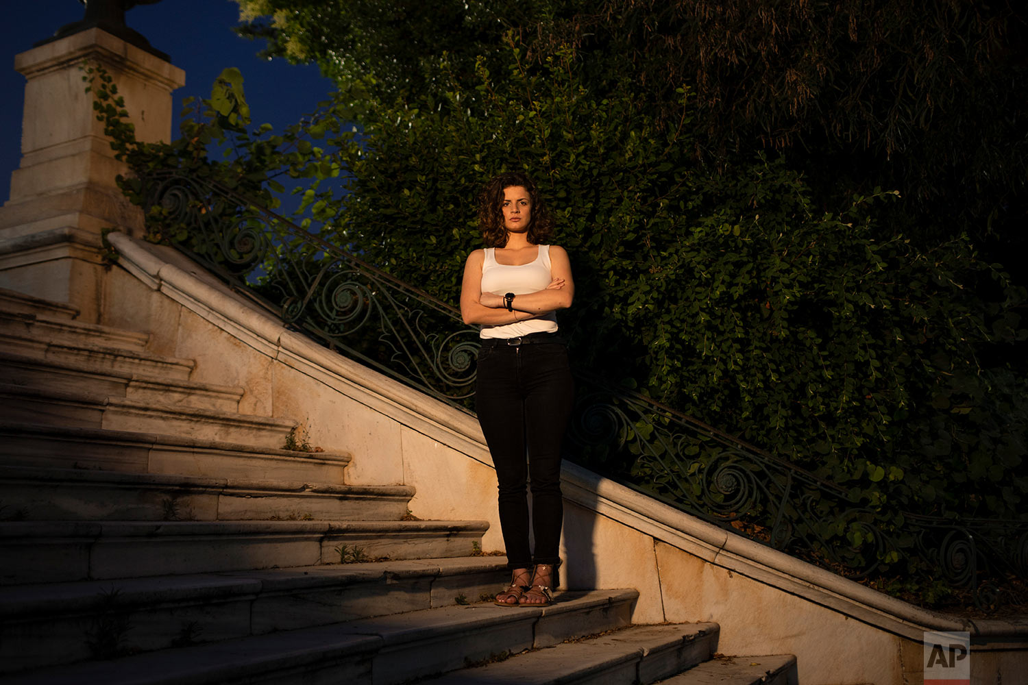 In this Monday June 24, 2019 photo Martha Markopoulou, a 24-year-old university student, poses for a photo in Athens.. (AP Photo/Petros Giannakouris)