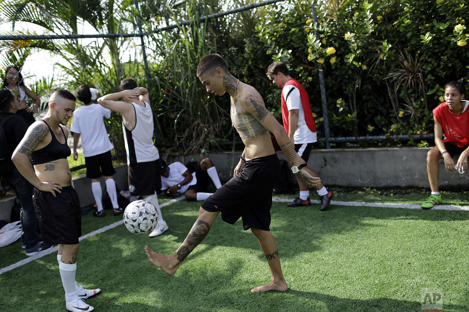 Caua Fraga kicks the ball during a practice session with the Bigtboys transgender men's soccer team in Rio de Janeiro, Brazil, May 13, 2019. The rise of Brazilian President Jair Bolsonaro and a socially conservative wave has alarmed the LGBT community, including the Bigtboys. (AP Photo/Silvia Izquierdo)