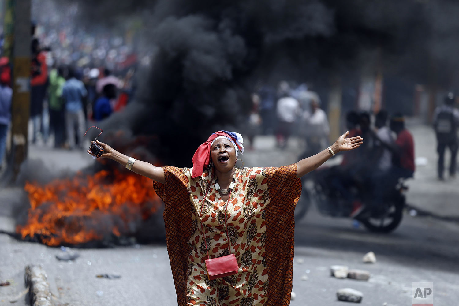 A protester yells anti-government slogans in Port-au-Prince, Haiti, June 9, 2019. Protesters denouncing corruption paralyzed much of the capital as they demanded the removal of President Jovenel Moise. (AP Photo/Dieu Nalio Chery)