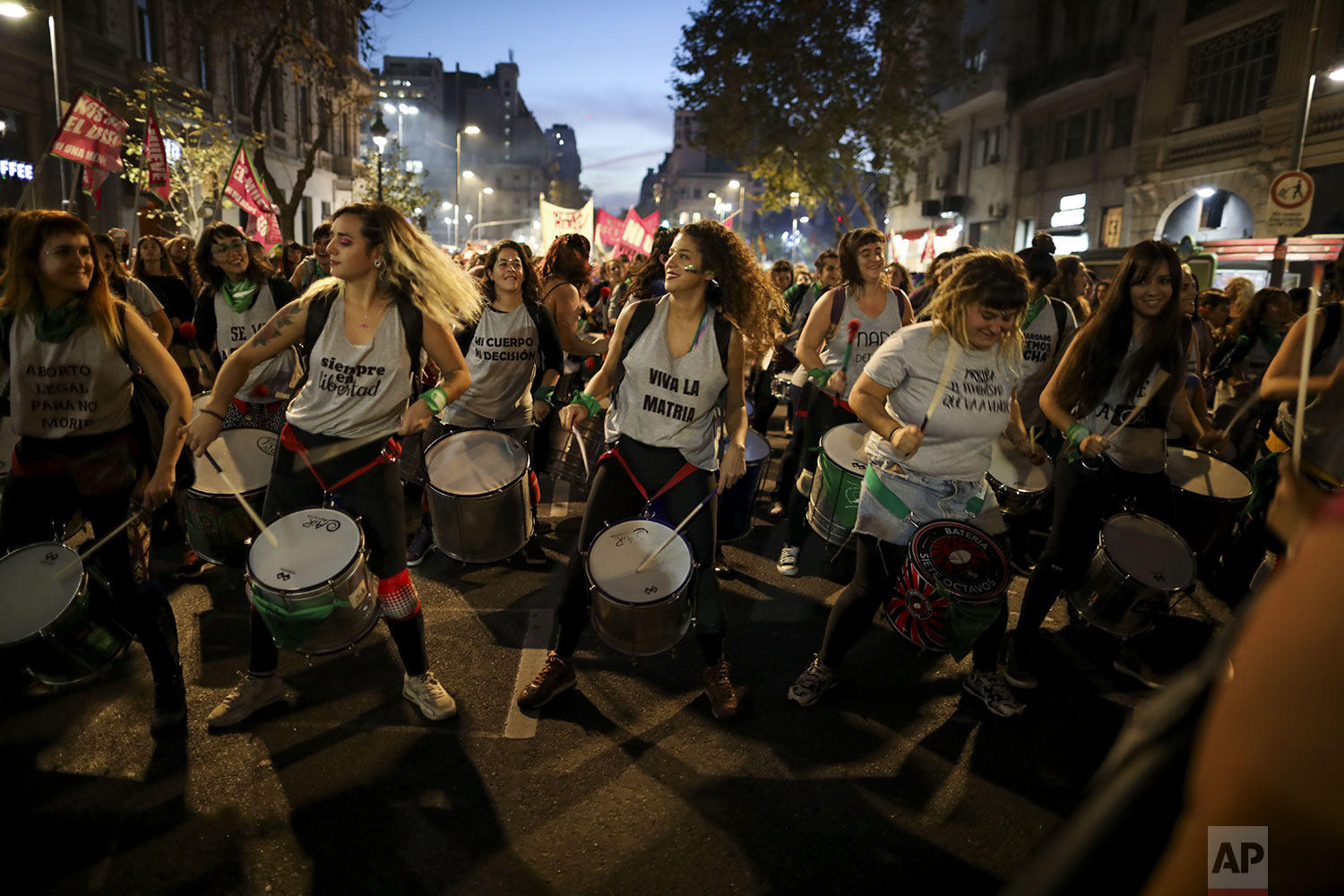 """Women play drums during a protest against gender violence in Buenos Aires, Argentina, Monday, June 3, 2019. The grassroots movement """"Ni una menos,"""" or Not One Less, is marking its fourth anniversary by remembering the hundreds of women who have been murdered since its founding, and demanding laws to curb sexist violence that continues to permeate Argentine society. (AP Photo/Natacha Pisarenko)"""