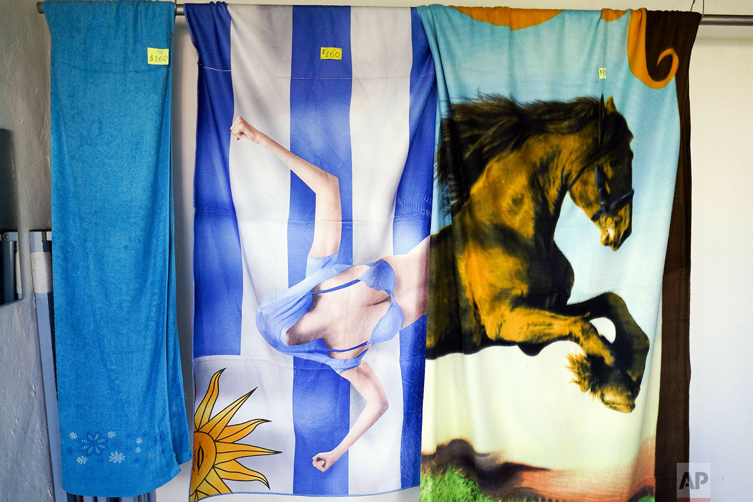Towels are displayed for sale at a clothing store run by an inmate at the Punta de Rieles prison, in Montevideo, Uruguay, May 15, 2019. The inmate who runs this business also studies economics at the university. (AP Photo/Matilde Campodonico)