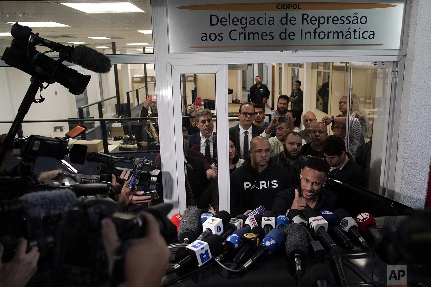 Brazilian soccer player Neymar gives a thumbs up after speaking to journalists as he leaves a police station where he spoke to police in Rio de Janeiro, Brazil, Thursday, June 6, 2019. Rio de Janeiro police said Thursday that soccer star Neymar was expected to testify in the investigation linked to a woman's rape allegation against him. (AP Photo/Leo Correa)