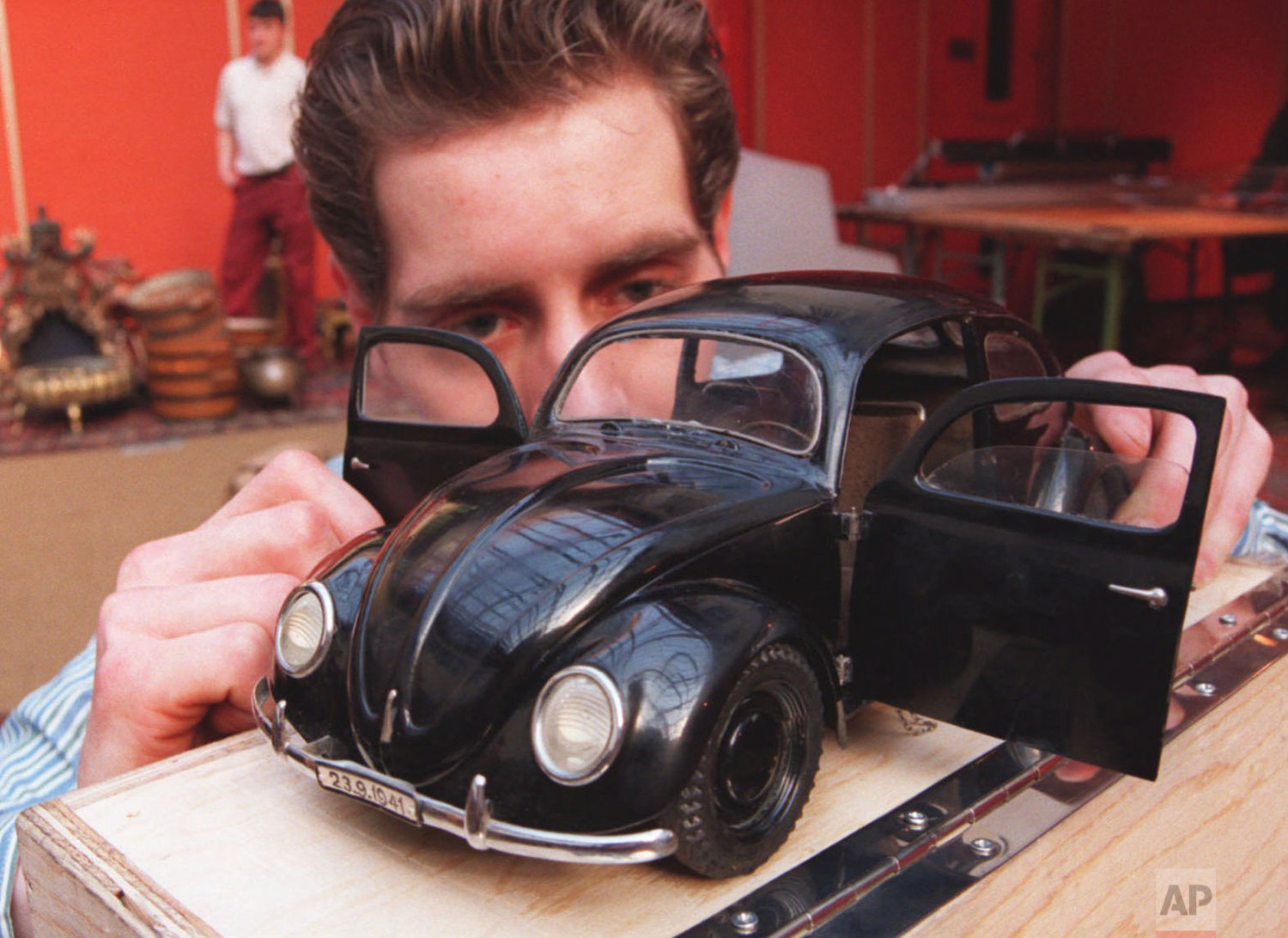Christie's porter Patrick Fornara takes a last look at a 1938 model of an early VW Beetle car bought by the Stuttgart based Bosch company for 42,550 Pounds (US$ 65,101), at the auctioneer's west London headquarters, Feb. 29 1996. (AP Photo/Charles Miller)