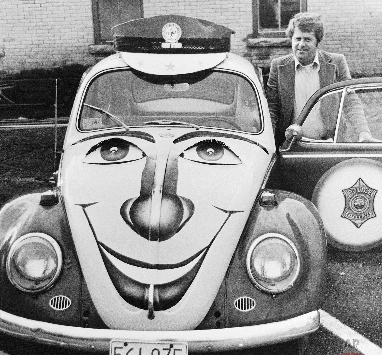 Fitchburg Police Youth officer, Det. Sgt. James R. Conry, stands beside his modified compact Volkswagen Beetle, Oct 26, 1976 in Fitchburg, Mass. (AP Photo)