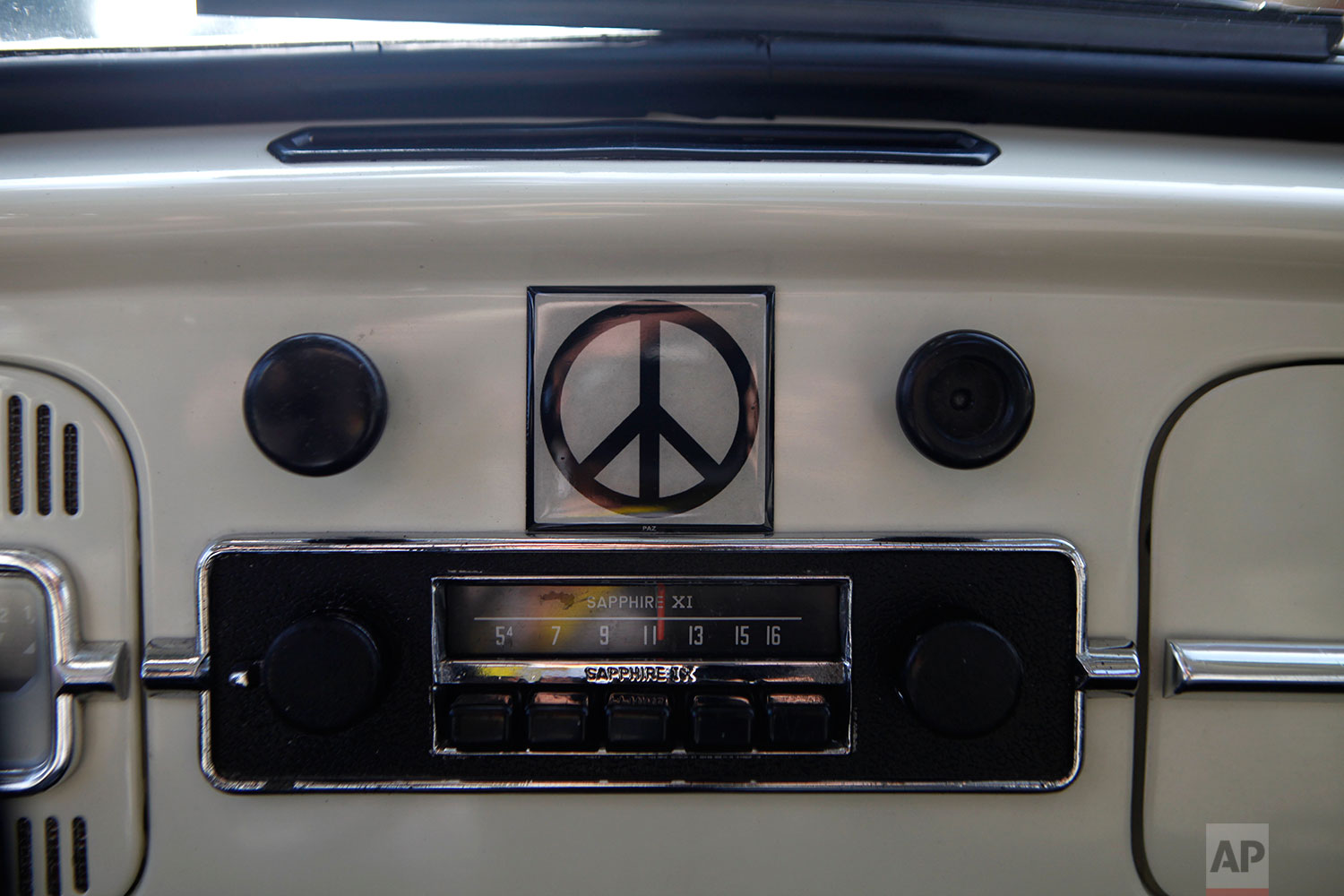 The inside of a 1967 classic Volkswagen beetle adorned with a peace sign at Driver's Volks event in Mexico City, Aug. 16, 2015. (AP Photo/Sofia Jaramillo)