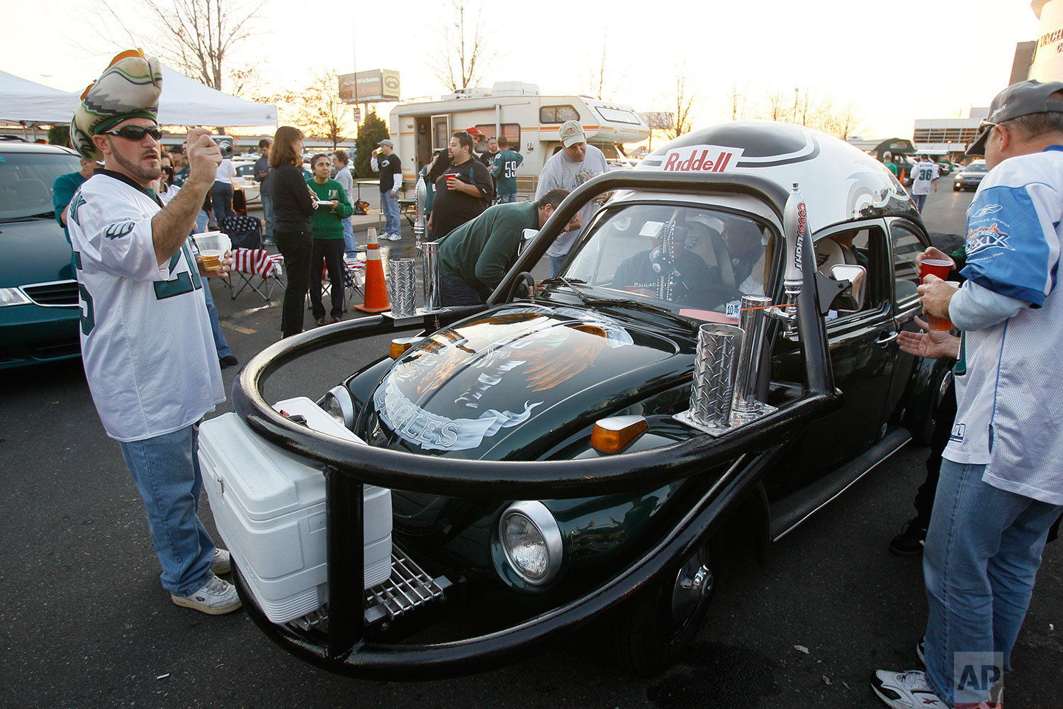 Philadelphia Eagles fans show off their customized Volkswagen Beetle before an NFL football game against the Dallas Cowboys, Nov. 8, 2009, in Philadelphia. (AP Photo/Matt Slocum)