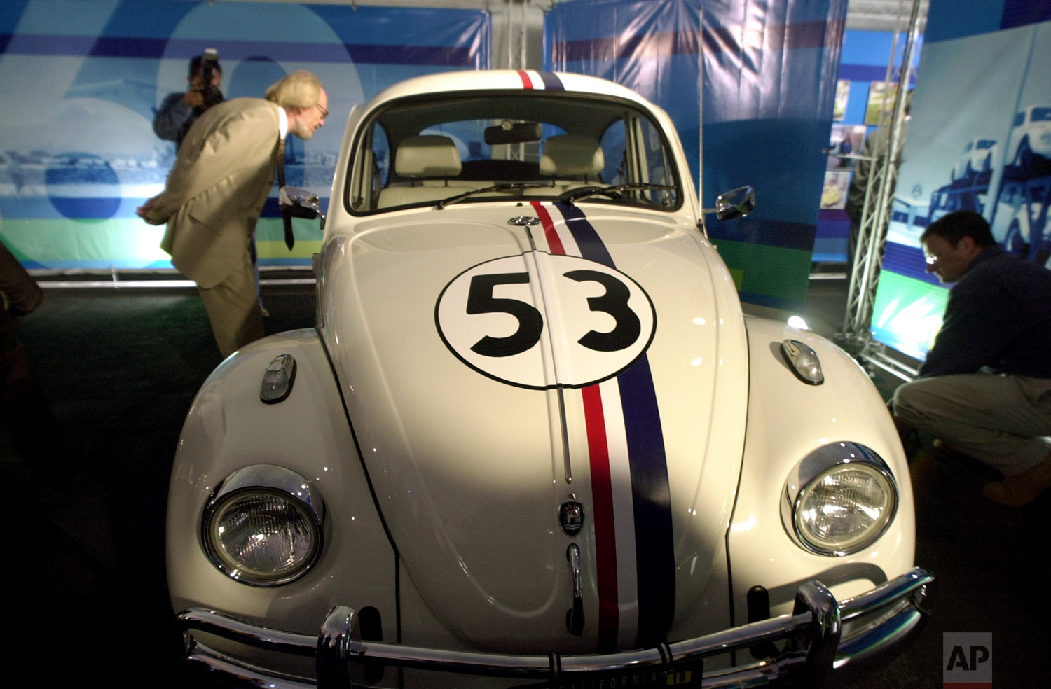 The replica of Herbie the Love Bug, the star of the wacky 1970s movie of the same name, is exhibited during the ceremony of the Volkswagen sedan 'last edition,' July 10, 2003, at the Puebla plant, in Mexico. (AP Photo/Jose Luis Magana)
