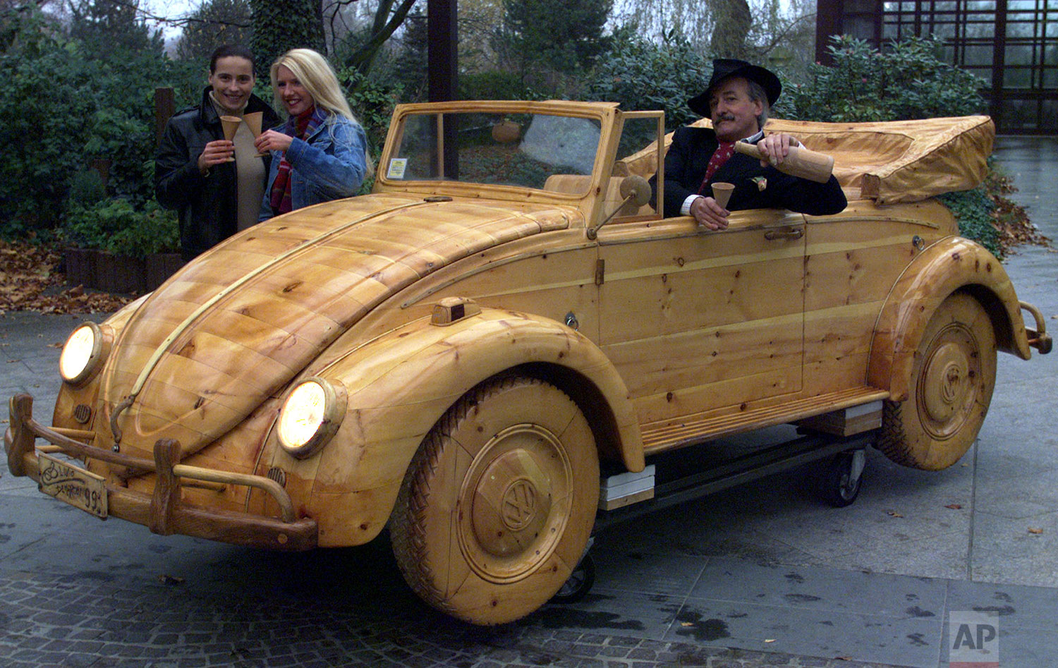 A VW Maggiolino Cabriolet, the famous VW Beetle completly made of wood, is shown by Italian artist Livio De Marchi, Nov. 17, 1999 in Essen, Germany.  (AP Photo/Karl-Heinz Kreifelts)