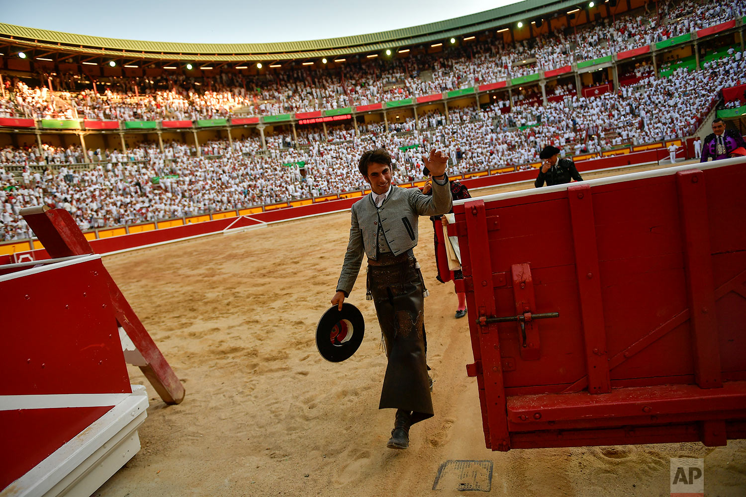 Roberto Armendariz, 33, Spanish ''rejoneador'' or mounted bullfighter, waves at the end of his performance during a horseback bullfight at San Fermin Fiestas, northern Spain, July 6, 2019. (AP Photo/Alvaro Barrientos)